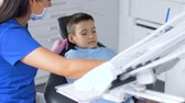 estomatologia : female dentist with kid patient at dental clinic