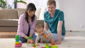 bloco : happy family with baby boy playing at home
