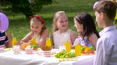 prato : happy kids on birthday party at summer garden