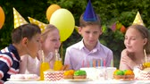 свеча : happy kids on birthday party at summer garden