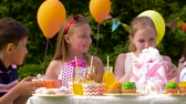подарок : kids giving presents to birthday child at party