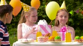 doce : kids giving presents to birthday child at party