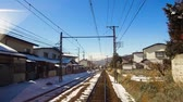trilho : view to suburb from train or railway in japan