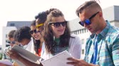workbook : group of happy students with notebooks at campus Stock Footage
