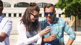 campus : friends with drink and smartphone in city