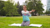 протяжение : woman exercising on yoga mat at park