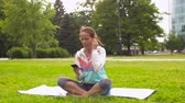 meditar : woman with smartphone putting music for meditation
