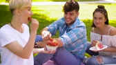 melão : friends eating fruits at picnic in summer park