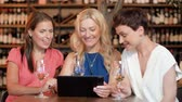 festivo : women with tablet pc at bar wine or restaurant