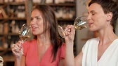 подарок : women with gift drinking wine at bar or restaurant