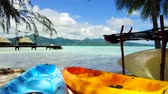 extremo : kayaks moored on beach in french polynesia