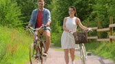 fixní : happy couple with fixed gear bicycles in summer