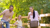ciclismo : happy family riding bicycles in summer park