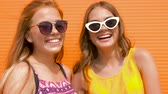 redhead : smiling teenage girls in sunglasses outdoors Stock Footage