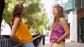 güneş gözlüğü : teenage girls or friends talking in summer city