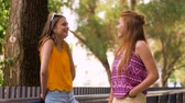 güneş gözlüğü : teenage girls or friends talking in summer park