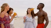 limonada : friends clinking non alcoholic drinks on beach Vídeos