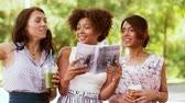 find out : women with city guide and drinks on street