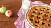 maçãs : close up of apple pie and glass of milk on table