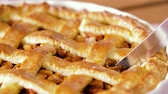 assar : close up of apple pie slicing by knife