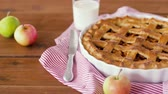 углеводы : close up of apple pie and glass of milk on table