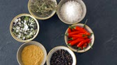 curry : bowls with different spices on wooden table Stock Footage