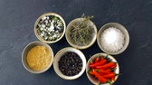 seasonings : bowls with different spices on wooden table Stock Footage