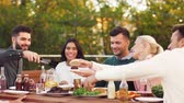 fast food : friends eating and sharing food at rooftop party Stock Footage