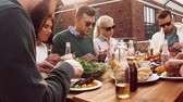 cobertura : friends having dinner or bbq party on rooftop Stock Footage