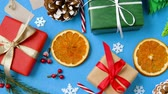 cana : christmas gifts and decorations on blue background
