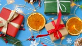 envolto : christmas gifts and decorations on blue background