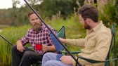 free country : friends fishing and drinking tea from flusk