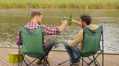 free country : happy friends fishing and drinking beer on lake