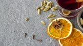cardamom : hot mulled wine, orange slices, raisins and spices