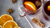 seasonal : glasses of hot mulled wine with orange and spices