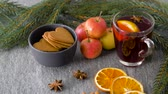 fruit slice : glass of hot mulled wine, cookies, apples and fir Stock Footage