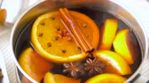seasonings : pot with hot mulled wine, orange slices and spices