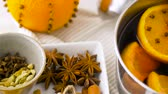 cardamom : spices and hot mulled wine with orange slices