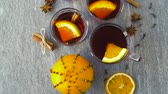 advento : glasses of hot mulled wine with orange and spices
