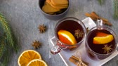 glasses of hot mulled wine with orange and spices