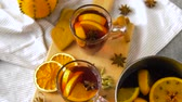 cardamom : glasses of hot mulled wine with orange and spices