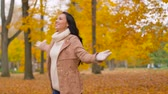 brasão : happy young woman in autumn park