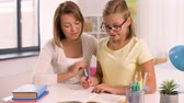 iskoláslány : mother and daughter doing homework together