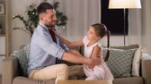 pre teen : father and daughter tickling and having fun Stock Footage