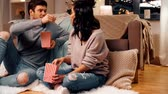 cosiness : happy couple eating pop corn at home