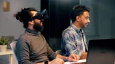 interativo : developers with virtual reality headset at office