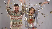 atlamacı : happy couple at christmas party under confetti Stok Video