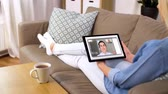 マグカップ : woman having video call on tablet computer at home