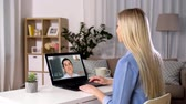 hirer : woman having video call on laptop computer at home