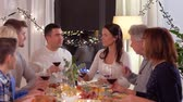 vnuk : happy family having dinner party at home Dostupné videozáznamy